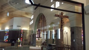 This is a close-up view of the crucifix and Sanctuary Lamp at Holy Spirit Catholic Church in Tempe, AZ